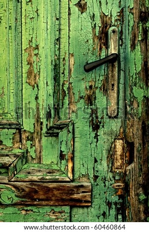 Old green door close-up with handle
