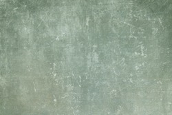 Old green grungy wall background or texture