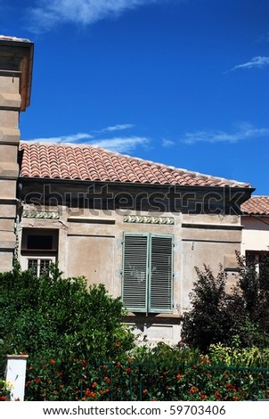Old green rural wood shutter on mediterranean house