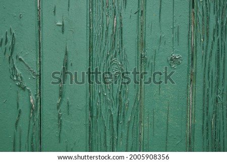Old green wooden wall with cracked paint, background texture. High quality photo Foto stock ©