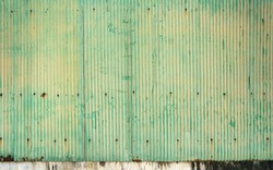 old green zinc and rust. rust on old green zinc background wall. Rusty corrugated metal wall. Old green zinc wall surface Fence house zinc background.