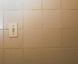 Old, grimy light switches isolated against dirty and greasy walls.