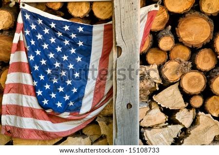 Old grunge american flag against firewood background