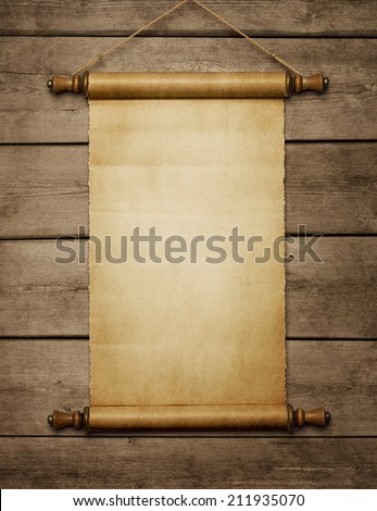 Old grunge blank paper scroll on the wooden wall with copy space