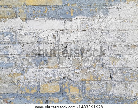Old grunge brick painting wall for background. Blue white and yellow brick texture image. Colorful texture surface design.