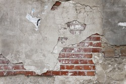 Old grunge brick wall and plaster