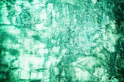 Old Grunge Concrete Wall Background in Aqua Menthe Green Color Tone, Suitable for Construction and Architecture Concept.