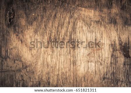 Old grunge dark textured wood background #651821311