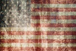 Old grunge flag of United States of America with original color, on damaged paper