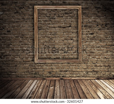 old grunge interior with blank picture frame against wall - stock photo