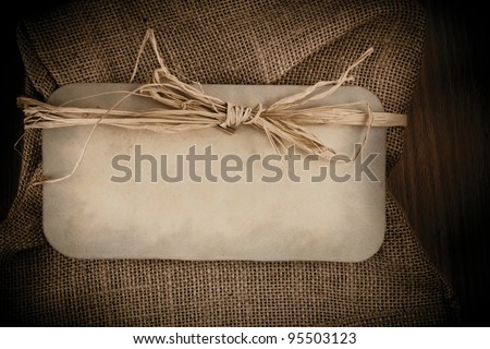 Old Grunge Paper on burlap background