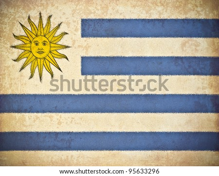 old grunge paper with Uruguay flag background