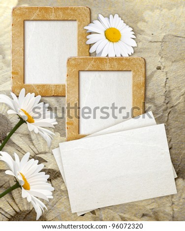 Old grunge photo frame with daisy and paper for letter