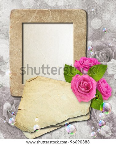 Old grunge photo frame with roses and paper for letter