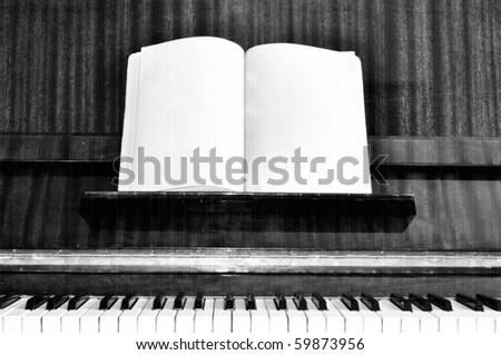 Old grunge piano keys with effect of old retro movie and note sheet
