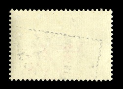 Old grunge posted stamp, reverse side
