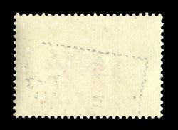 Old grunge posted stamp, reverse side
