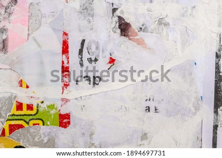 Old grunge ripped torn vintage collage colorful street posters creased crumpled paper surface placard texture background backdrop Foto d'archivio ©