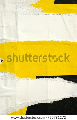 Old grunge ripped torn vintage collage posters creased crumpled paper surface placard texture background backdrop / Space for text