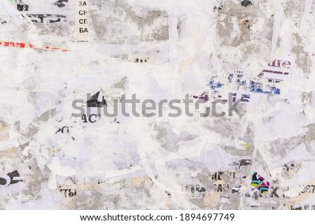 Old grunge ripped torn vintage collage street posters creased crumpled paper surface placard texture background backdrop Foto d'archivio ©