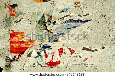 Old grunge ripped torn vintage collage street posters / Creased crumpled paper surface texture background #548649199