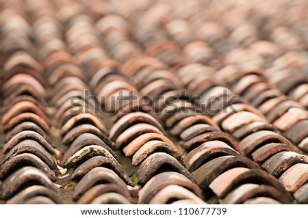 Old grunge tile roof with shallow depth of field