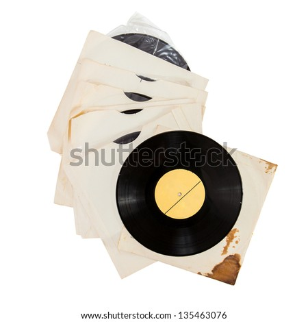 Old grunge vinyl records in paper covers isolated over white