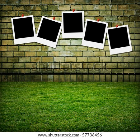 old grunge wall with picture frames - stock photo
