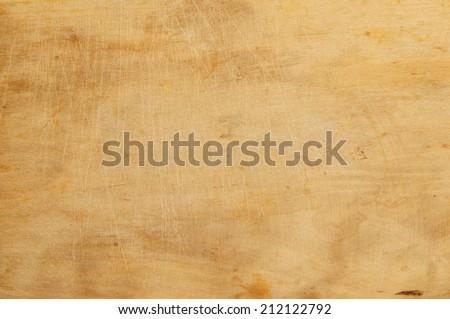 Old grunge wooden kitchen cutting board as background