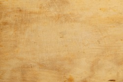 Old grunge wooden kitchen cutting board as background, chopping board close up