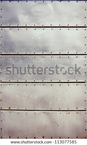 Old grungy, dirty and scratched metal plates with screws