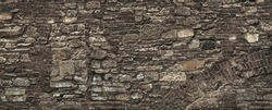 Old grungy retro grimy brick wall of ancient city. Uneven dirty pitted peeled surface brickwork of cellar worn. Ruined solid bumpy stiff blocks. Hard messy ragged holes brickwall for 3D grunge design