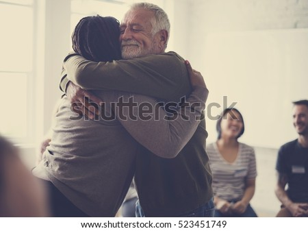 Shutterstock Old guy consoling a woman with a hug