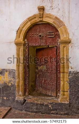 Old half-opened door in Casablanca, Morocco.