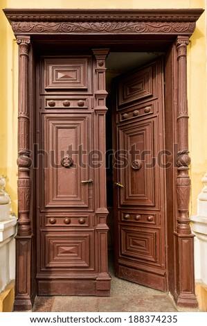 Old Half Opened Wooden Door In Church #188374235