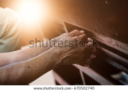 old hand  praying in the church ...