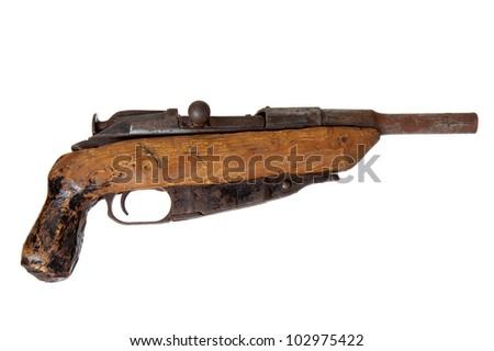 Old handmade shotgun isolated on white background