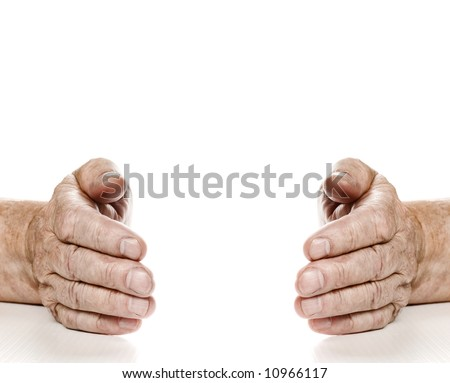 Old hands with copy-space between them. Isolated on white background