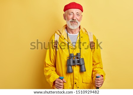 old handsome man traveler hicking in the mountins. close up photo. pleasure concept. sporty helathy lifestyle . close up photo