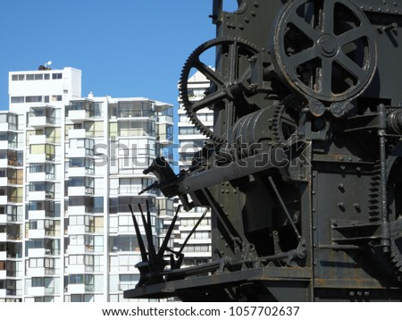 Old harbor crane gears hook and steel ropes #1057702637