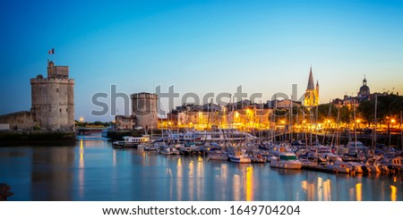 Old harbor of La Rochelle, France at night
