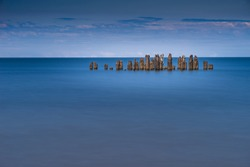 Old harbor ruins. Blue sea and port. Harbour in Baltic sea, Latvia, Europe
