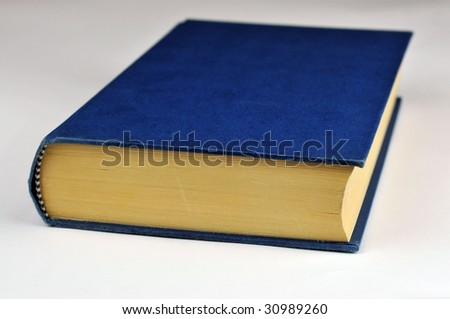 old  hardback book isolated on a white background.