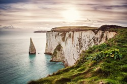 Old Harry Rocks, located at Handfast Point, on the Isle of Purbeck in Dorset, southern England, United Kingdom; the downlands of Ballard Down were formed approximately 66 million years ago