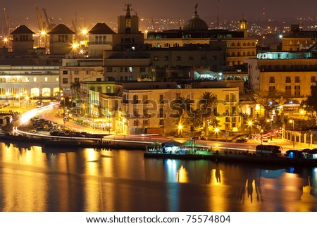 Old Havana and parts of the bay illuminated at night with reflections on the water