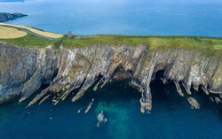 Old Head Kinsale Cork Ireland, aerial amazing scenery view on peninsula coast line cliffs and lighthouse