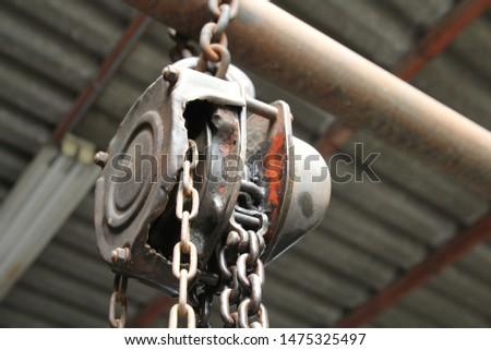 Old heavy duty crane hook in the garage in the garage