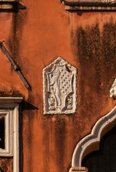 Old heraldic emblem with lion on a Venice orange wall