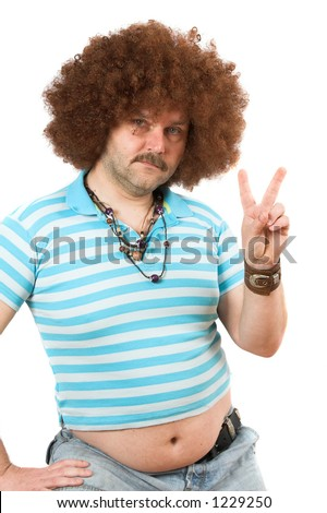 Old hippie with beerbelly hanging over his jeans making the peace sign