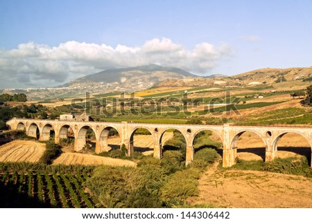 stock-photo-old-historic-aqueduct-like-rail-road-in-sicily-near-palermo-144306442.jpg